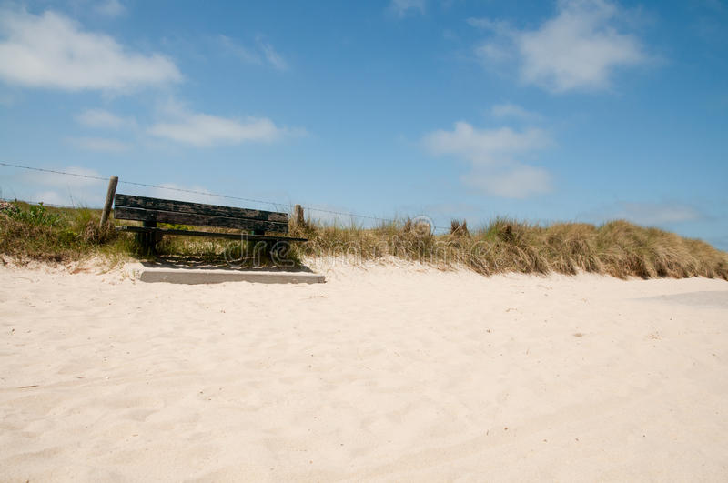 A bench in the dunes royalty free stock photos