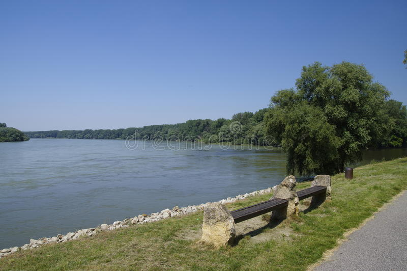 The bench on edge of Danube royalty free stock images