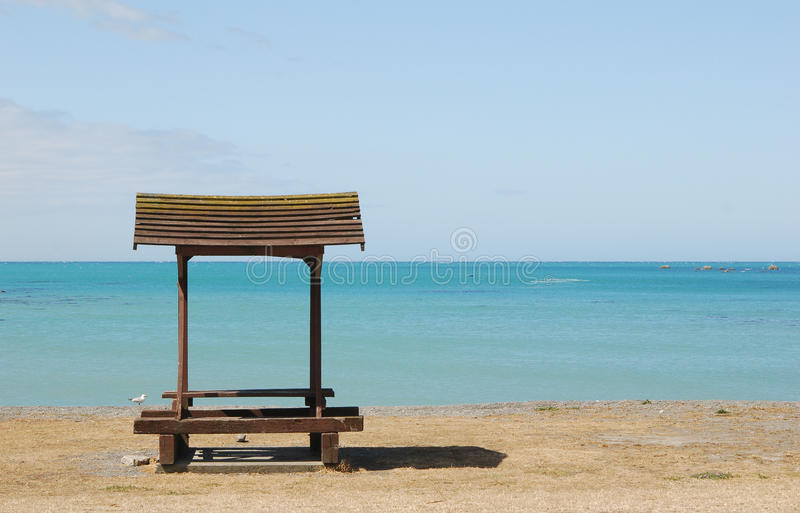 Download Bench At Empty Beach Royalty Free Stock Image - Image: 22743246
