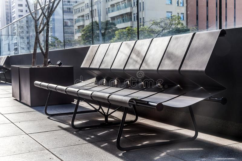 A bench in external area of a building stock images