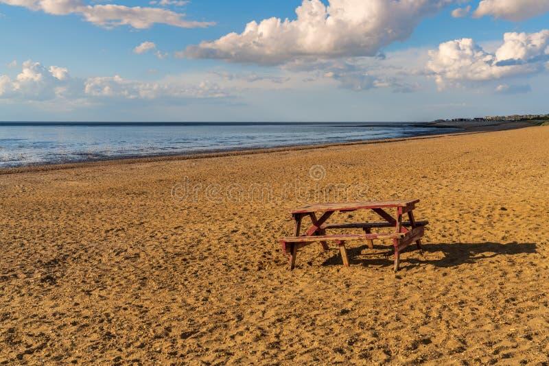 A bench on Heacham South Beach, Norfolk, England stock photography