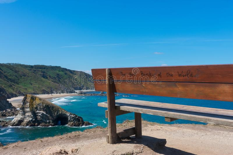Bench high on the cliff by the ocean royalty free stock images