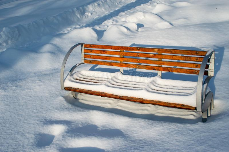 A bench illuminated by the winter sunset in the Roman Park, Neamt, Romania. Winter in the Roman Park Romania stock photos