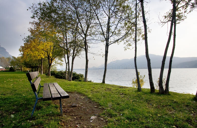 Bench by the lake stock image