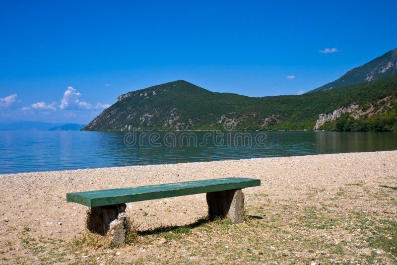 Bench at Lake Ohrid royalty free stock photography