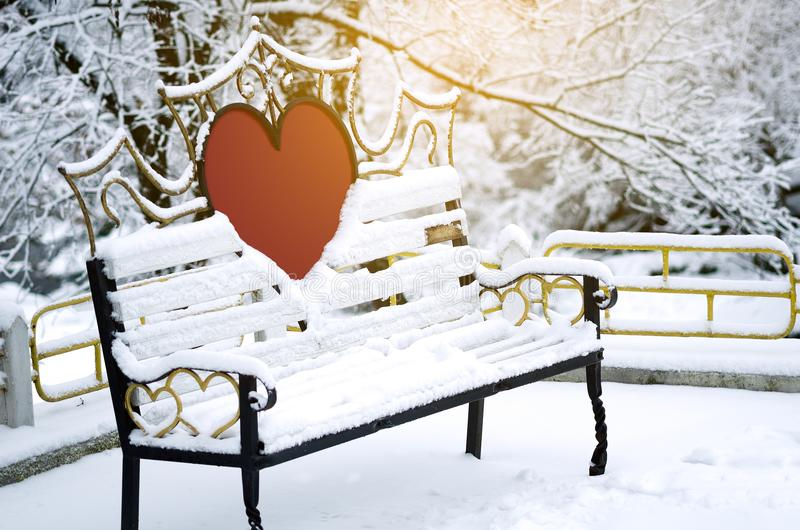 A bench for lovers in a winter park royalty free stock photos