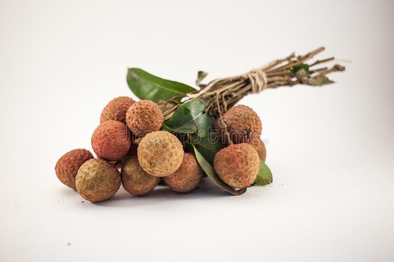 Bench of lychee isolated on white background stock photography