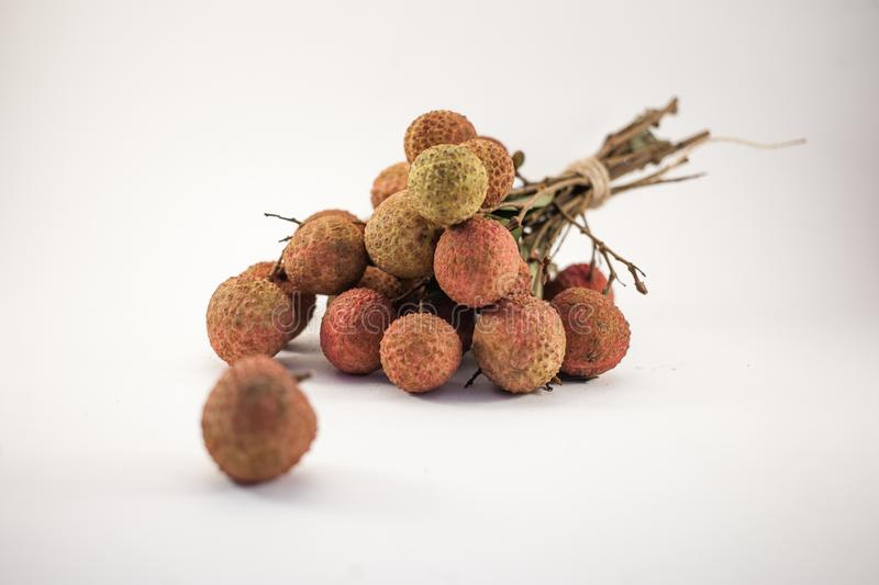 Bench of lychee  on white background royalty free stock photo