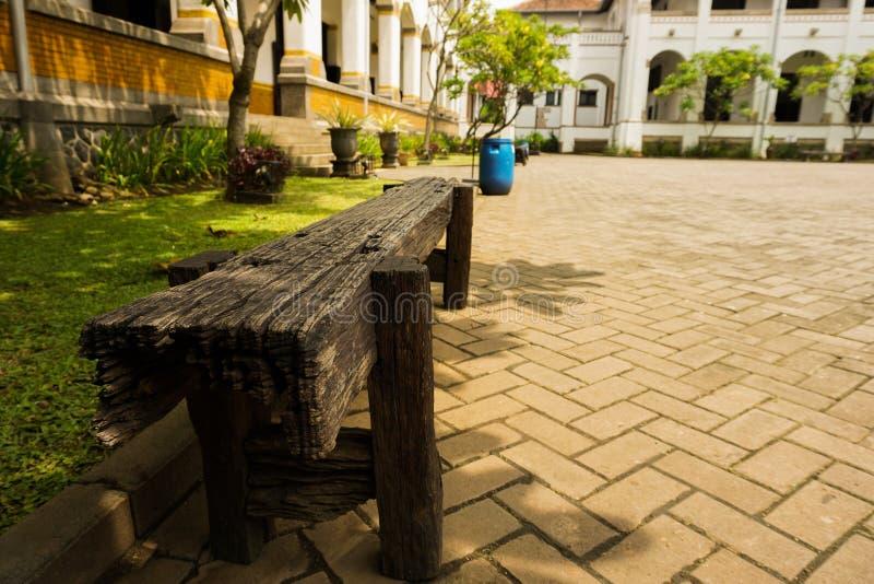 A bench made froom wood at Lawang Sewu photo taken in Semarang Indonesia. Java royalty free stock photo