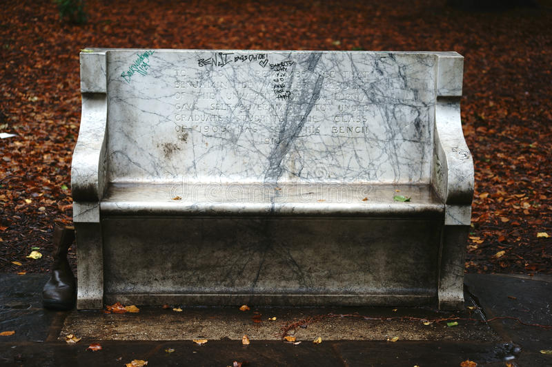 Bench with memorial inscription Berkeley. Berkeley, United States - December 21, 2015: A bench with a memorial inscription for the former president of the royalty free stock image