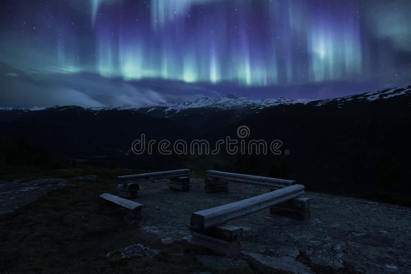 A bench in Norwegian National park with aurora stock image