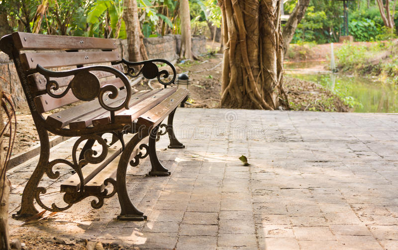 Bench in park. Image of bench in park for background usage royalty free stock images