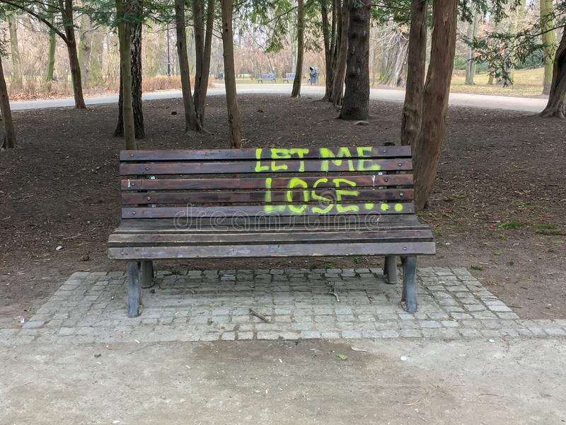 The bench in the park with text `Let me lose`. front view. royalty free stock image