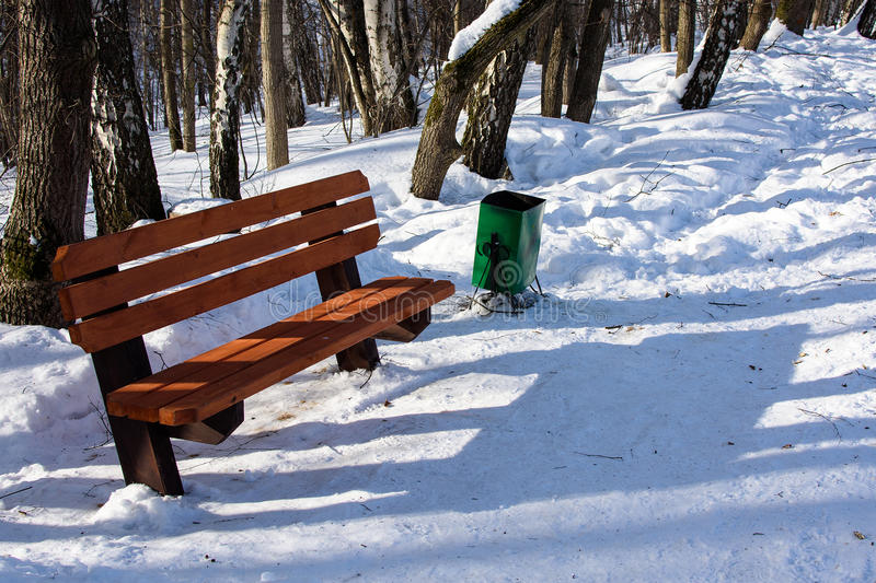 Bench in the park. Winter snow landscape in park royalty free stock photos