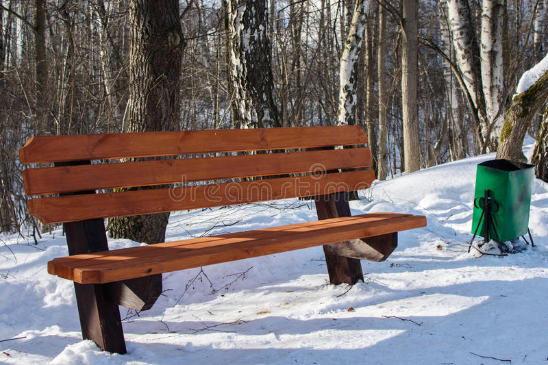 Bench in the park. Winter snow landscape in park royalty free stock images