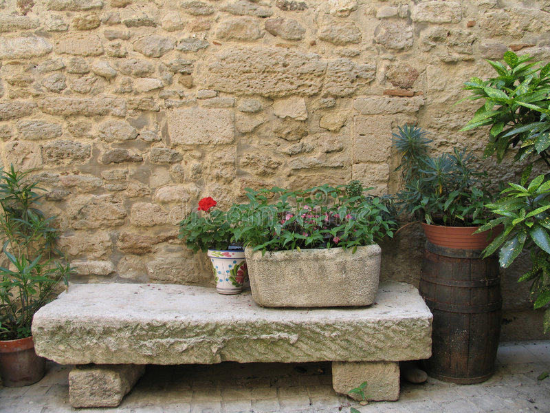 Bench in patio. Detail from little French town royalty free stock image