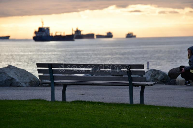 The bench on the point of the park.  royalty free stock photography
