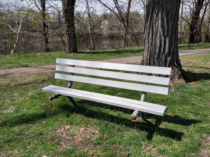 Bench in a Public Park, Rutherford, NJ, USA. A place to sit, near the Passaic River in Memorial Park in Rutherford, New Jersey, USA. This photo was taken on stock image