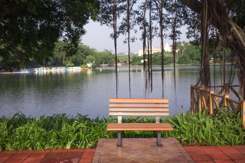 Bench beside the river stock images