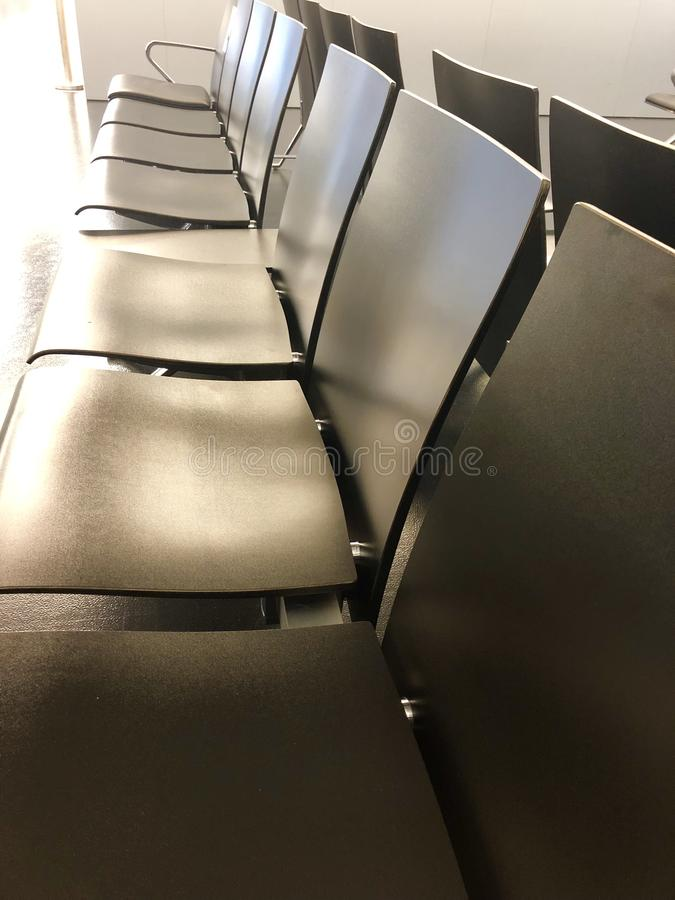 Row of airport benches stock image