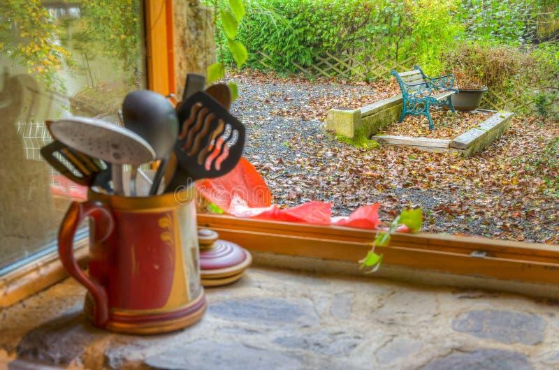 Bench seen through old kitchen window stock photos
