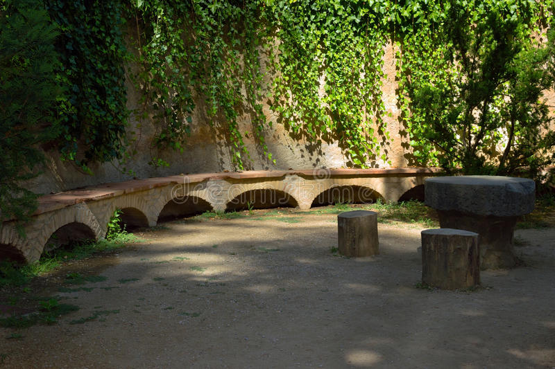 Bench stone. In Park Labyrinth in a beautiful garden. Barcelona. Catalonia. Spain stock photos