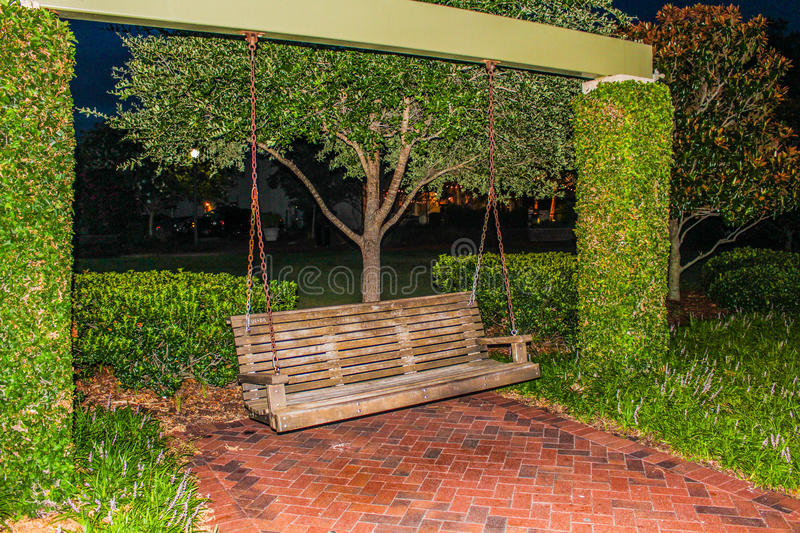 Bench swing at night on pier royalty free stock photos