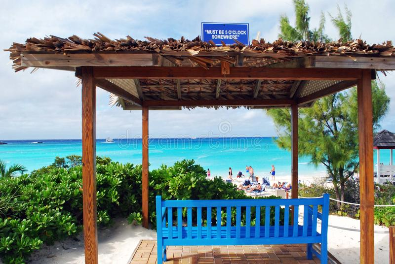 Scenic view half moon caye. Bench under a roof with catchy sign royalty free stock image
