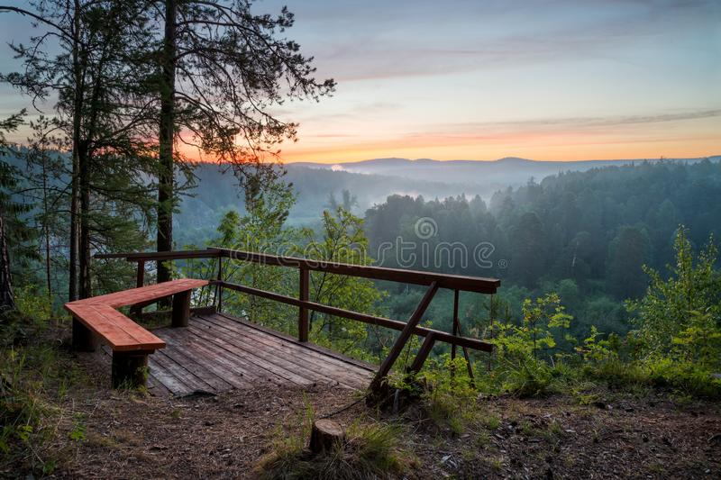 Bench with view of sunrise. At summer morning royalty free stock photography