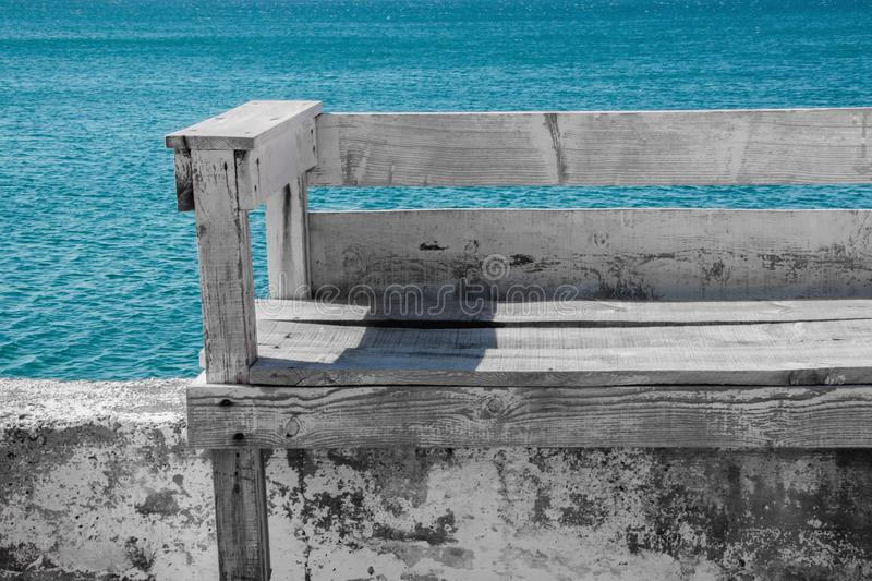 Bench on the wall to admire the sea from above royalty free stock photography