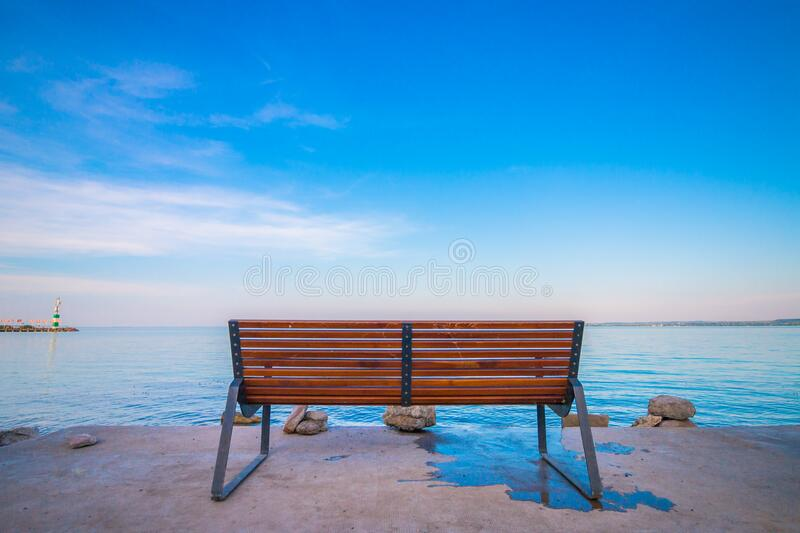 Bench on waterfront royalty free stock image