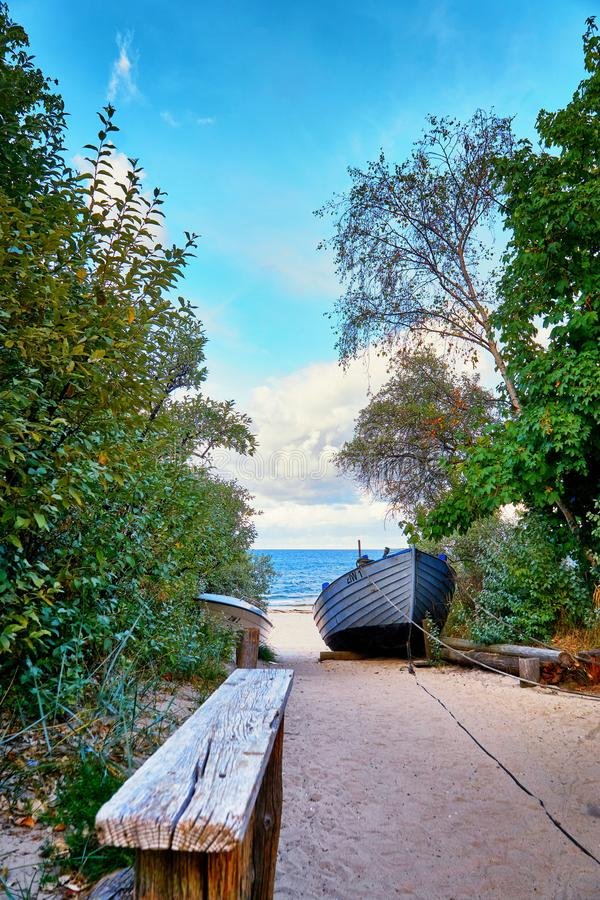 Bench on the way to the beach to the Baltic Sea. Zinnowitz on the island of Usedom stock images