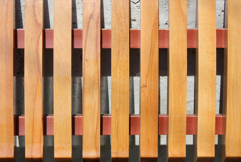 Bench. Wooden laths on a seat mat and on a back of a city shop stock photo