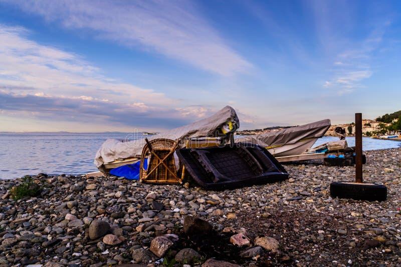 Benched Fisherman Rowboats stock image