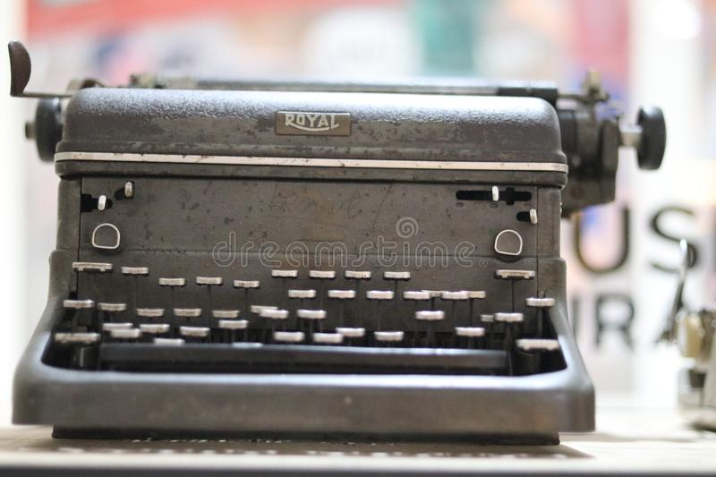 Benched steel Royal brand old school typewriter. Benched and aged grey steel old school typewriter, Royal brand, in Museum Surabaya stock image