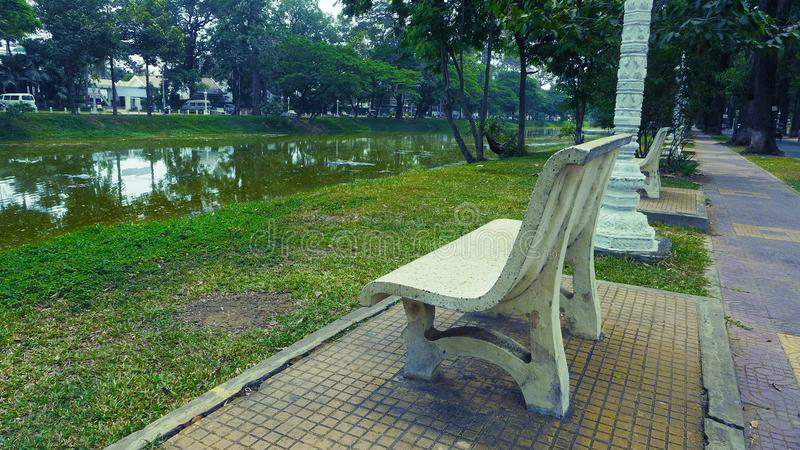 Benches behind Siem Reap River, Cambodia stock photography