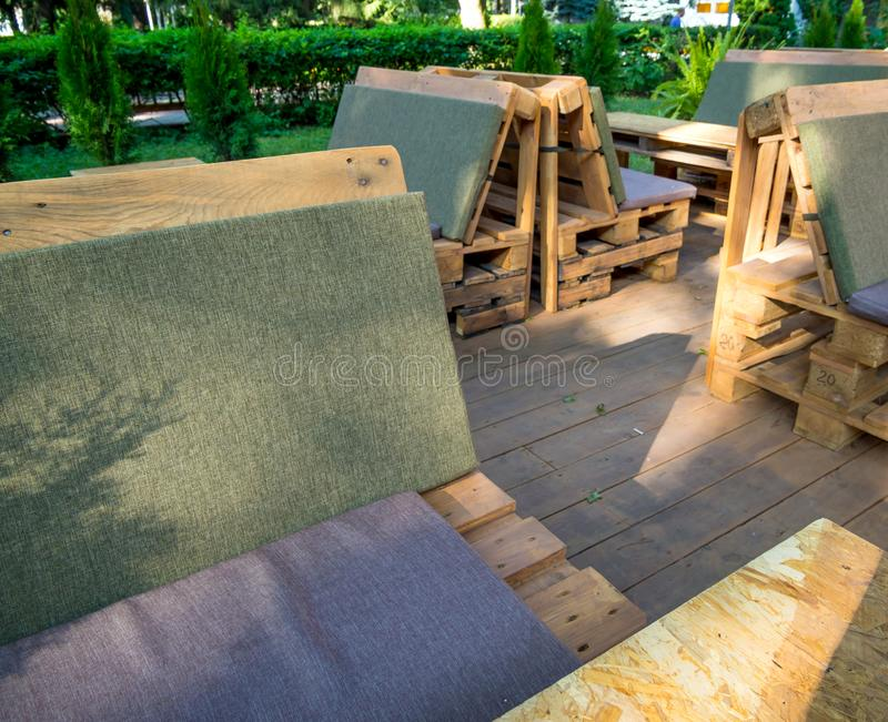 Benches in a cafe on the street from the old pallets royalty free stock photos