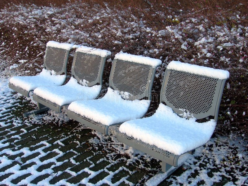 The benches and snow stock photos