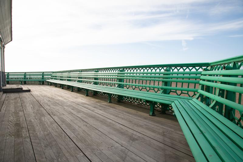 The benches on St Annes on Sea Pier Fylde Coast Febaurry 2019. The green benches on St Annes on Sea Pier Fylde Coast Febaurry 2019 royalty free stock images