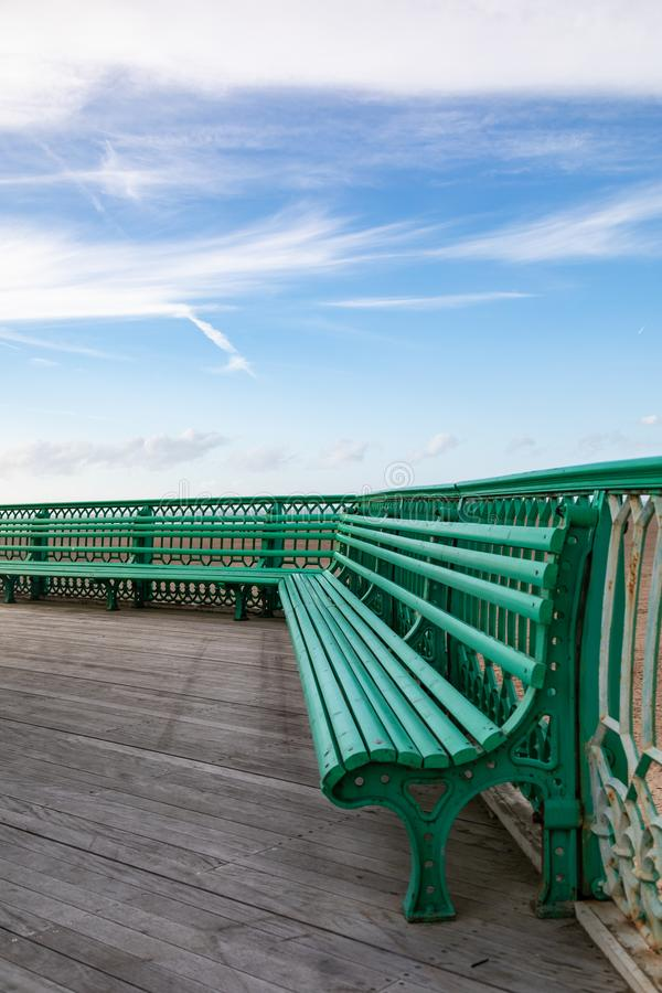 The benches on St Annes on Sea Pier Fylde Coast Febaurry 2019. The green benches on St Annes on Sea Pier Fylde Coast Febaurry 2019 royalty free stock photo