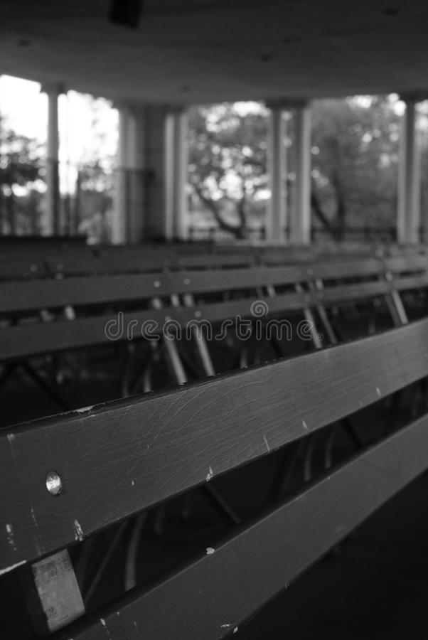 Benches under park shelter in black and white stock photo