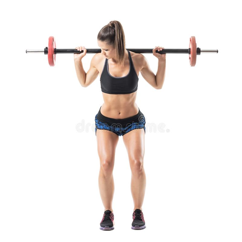 Bend low position of woman athlete doing shoulder press squat exercise. stock photography