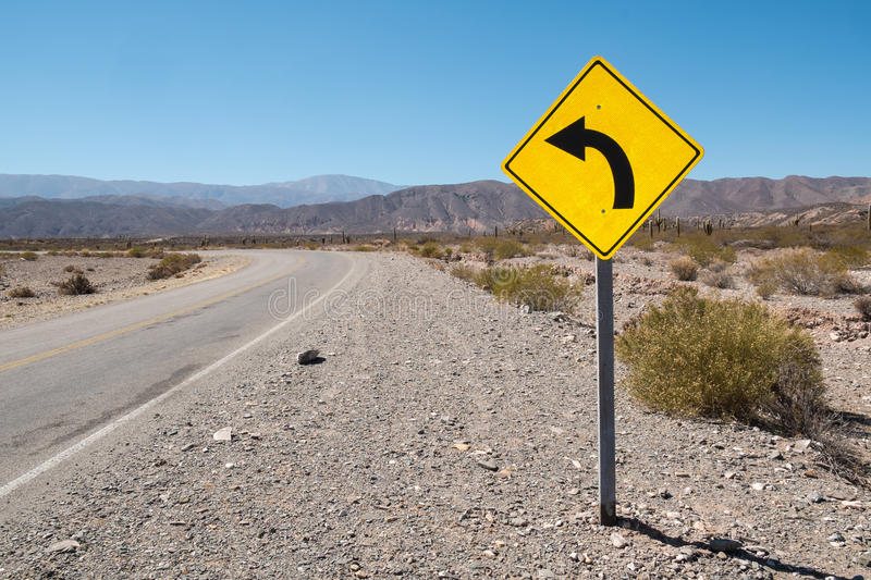 Bend traffic sign. Traffic sign warning of a bend in the Argentinian Andes royalty free stock photography