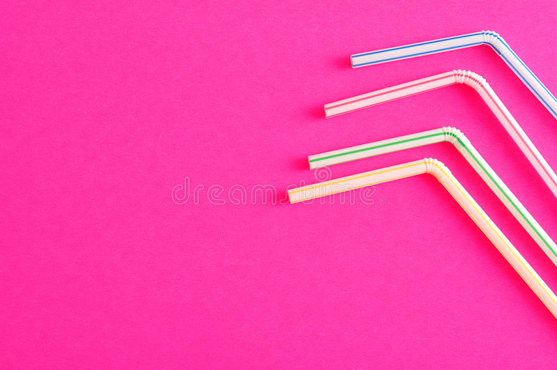 Bended drinking straws. On a pink background royalty free stock photos