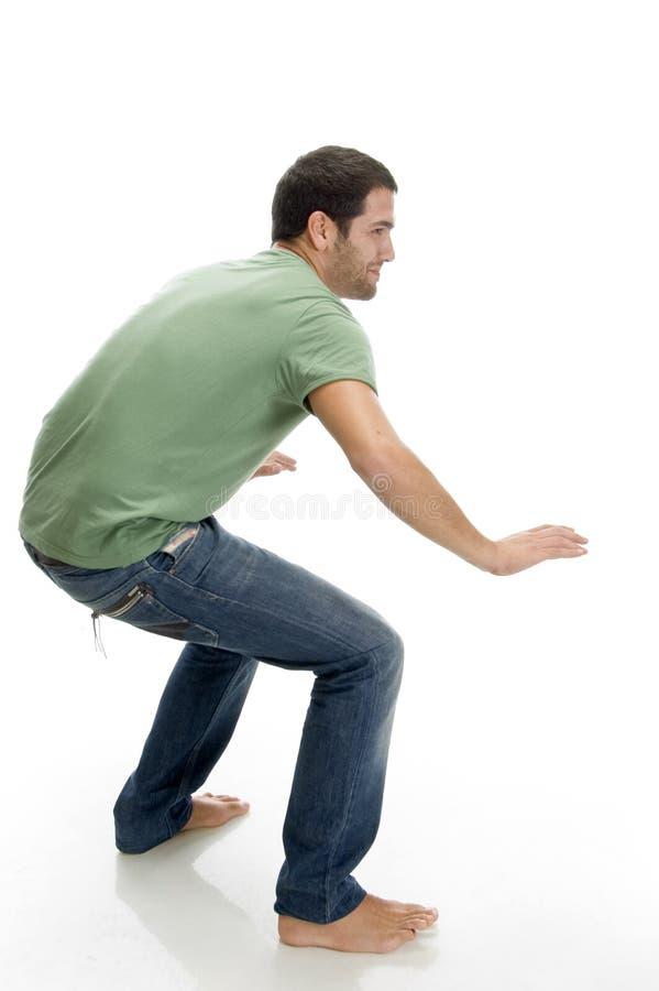 Bending man dancing royalty free stock photography