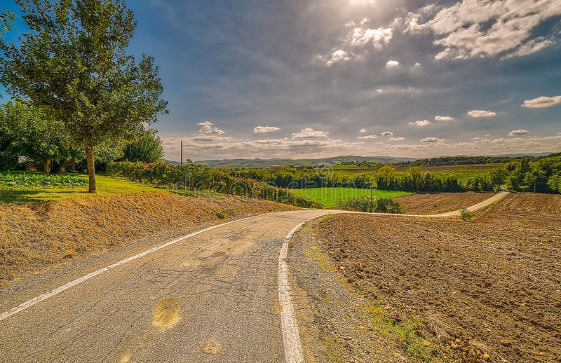 Bending road in Italian countryside royalty free stock photo
