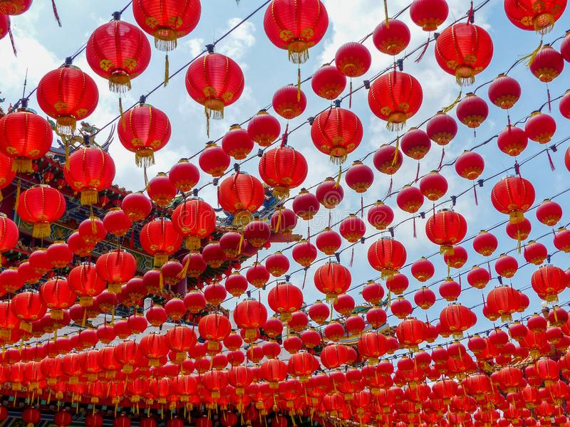 Beneath a canopy of red chinese lanterns at a chinese temple in malaysia. A colourful canopy of hundreds of red chinese lanterns at a chinese temple in Kuala royalty free stock photos