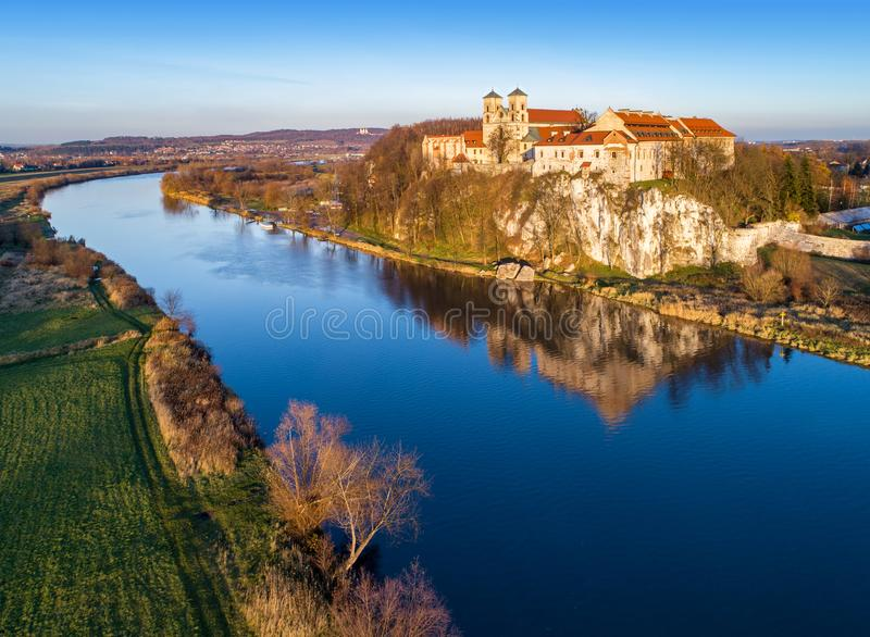 Benedictine abbey in Tyniec, Krakow, Poland. Vistula River. Tyniec near Krakow, Poland. Benedictine abbey on the rocky cliff and its reflection in Vistula River