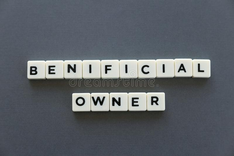 Beneficial owner word made of square letter word on grey background. Beneficial owner word made of square letter word on grey background stock photo