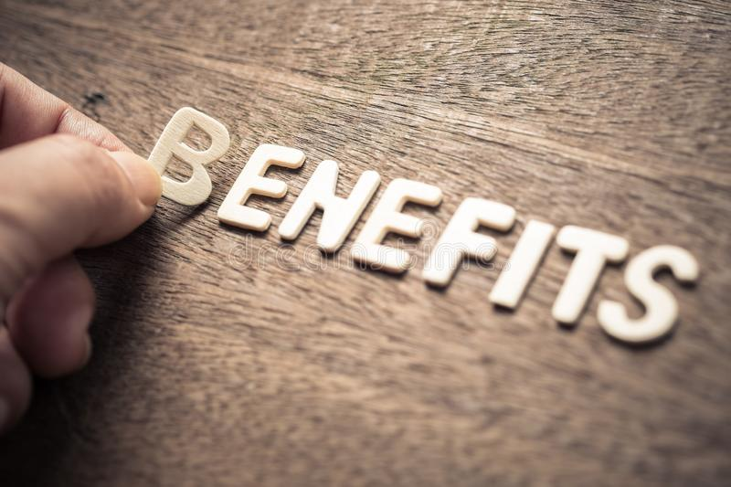 Benefits Wood Letters royalty free stock images